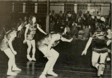 Piedmont women on defense in 1949 yearbook.