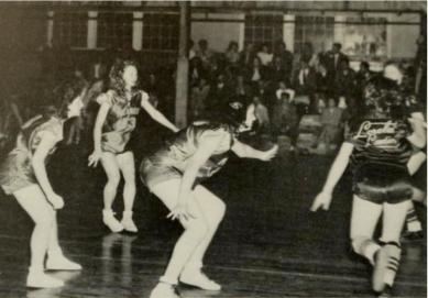 Piedmont women on defense in 1949 yearbook.