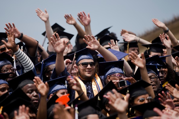 College grads have mostly waved goodbye to the extra aid Washington has sent their way in recent years. (AP Photo / Matt Rourke)